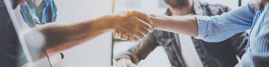Business partnership handshake concept.Photo two coworkers hands
